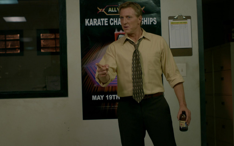 Coors Banquet Beer Bottle Held by William Zabka as Johnny Lawrence in Cobra Kai S02E10