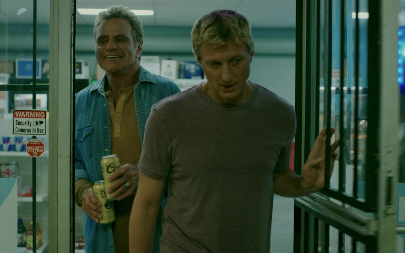 Coors Banquet Beer Cans Held by Martin Kove as John Kreese in Cobra Kai S02E02 Back in Black (1)