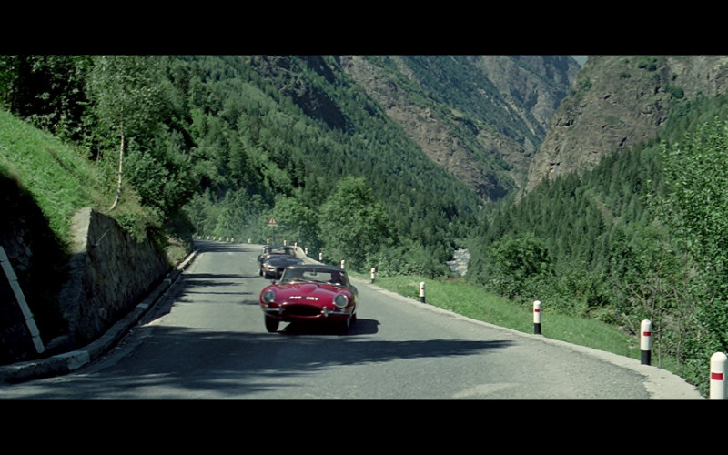Jaguar E-Type Cars (a red roadster and a black coupé) in The Italian Job (1969)