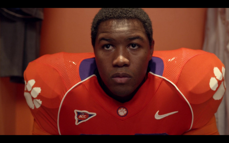 Nike Orange Football Jersey of Luke Tennie as Solomon in Safety