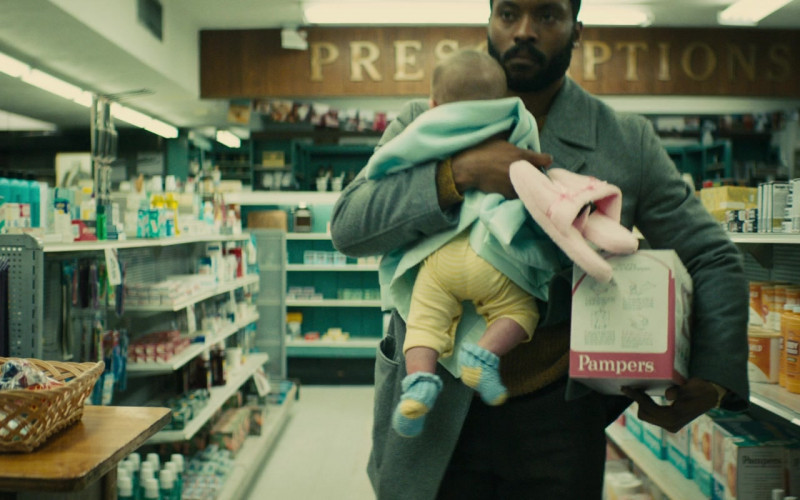 Pampers Diapers Box Held by Arinze Kene as Cal in I'm Your Woman (2020)
