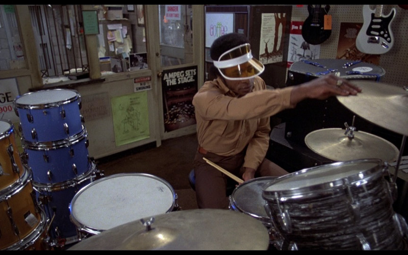 Ampeg Instrument company poster on the door at the bottom in The Blues Brothers (1980)