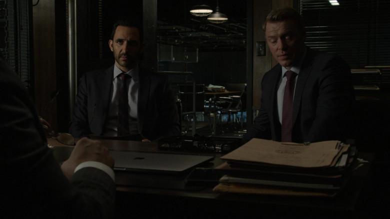 Apple MacBook Laptop (closed, on the table) of Harry Lennix as Harold Cooper in The Blacklist S08E04 Elizabeth Keen (2021)