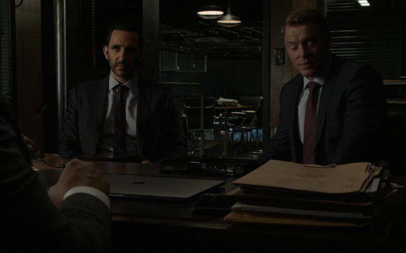 Apple MacBook Laptop (closed, on the table) of Harry Lennix as Harold Cooper in The Blacklist S08E04 Elizabeth Keen (2021)