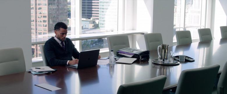 Apple MacBook Pro Laptop & Icelandic Glacial Water Bottle of Michael Ealy as Derrick Tyler