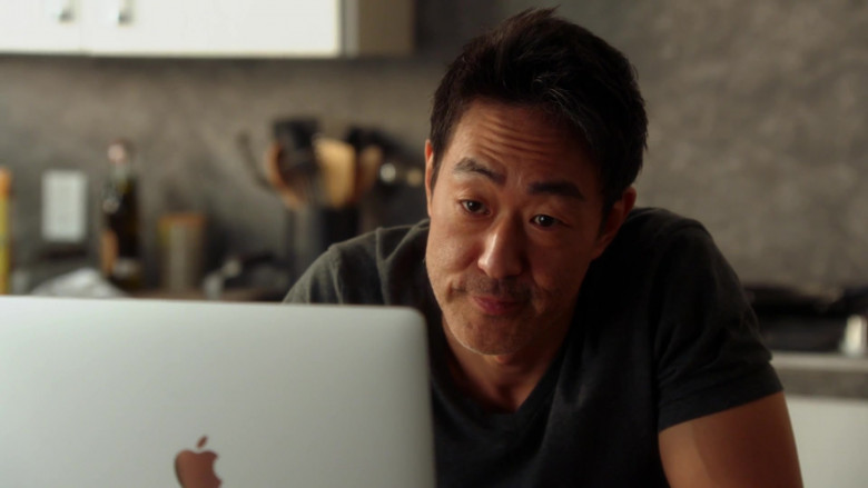Apple MacBook Pro Laptop of Kenneth Choi as Howard 'Howie' – 'Chimney' Han in 9-1-1 S04E01