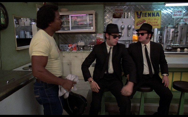 Augsburger beer round sign (one the left wall) and Vienna Sauce Sign in The Blues Brothers (1980)