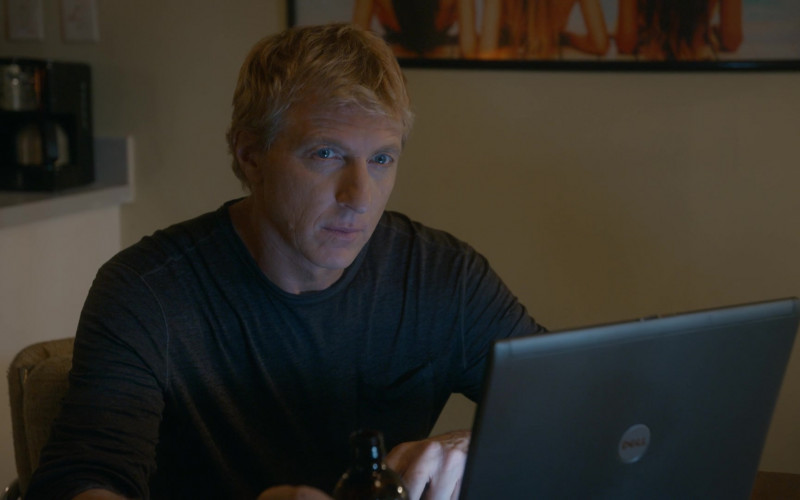 Dell Laptop of William Zabka as Johnny Lawrence in Cobra Kai S03E08