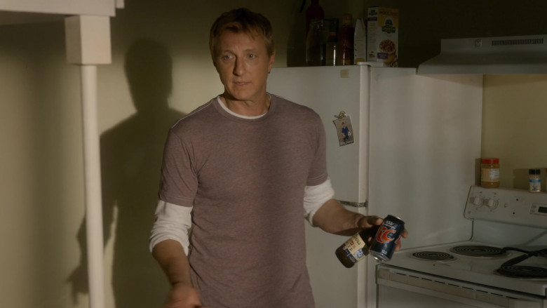 RC Cola and Coors Banquet Beer Cans Held by William Zabka as Johnny Lawrence in Cobra Kai S03E06