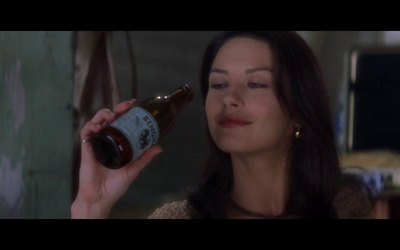 Singha Beer of Catherine Zeta-Jones as Virginia 'Gin' Baker in Entrapment (1999)