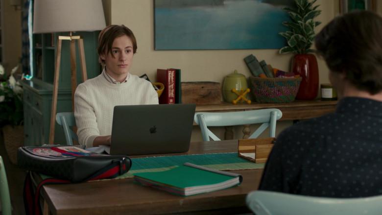 Apple MacBook Laptop of Logan Pepper as Cooper Bradford in American Housewife S05E08