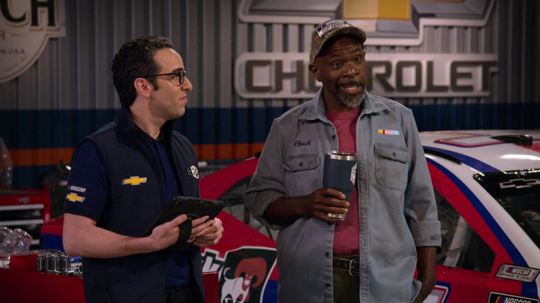 Chevrolet Logos on the Clothing of Dan Ahdoot as Amir in The Crew S01E07