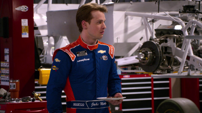 Chevrolet, Sunoco, Sparco and Goodyear Logos on the Racing Suit in The Crew S01E03