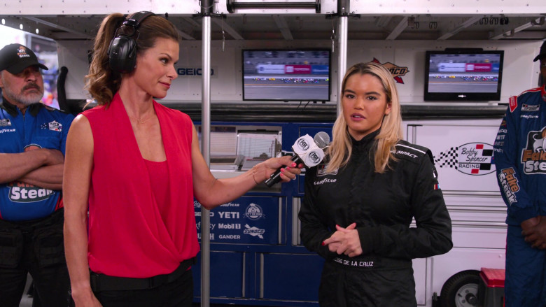 Impact Racing and Goodyear Logos on the Racing Suit of Paris Berelc as Jessie De La Cruz, Fox TV Channel, Yeti, Mobil 1, Gander, Pit Boss and Sunoco in The Crew S01E07