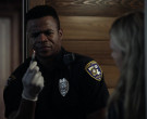Motorola Radio of Marque Richardson as Police Officer Tom Jo...