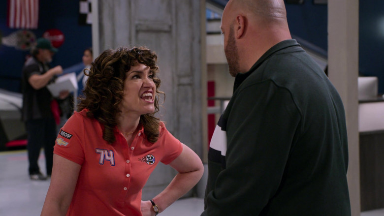 Nascar and Chevrolet Logos on the Polo Shirt of Sarah Stiles as Beth in The Crew S01E06