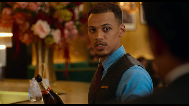 Piper-Heidsieck Champagne Held by Jordan Bolger as Cameron in Tom and Jerry (2)