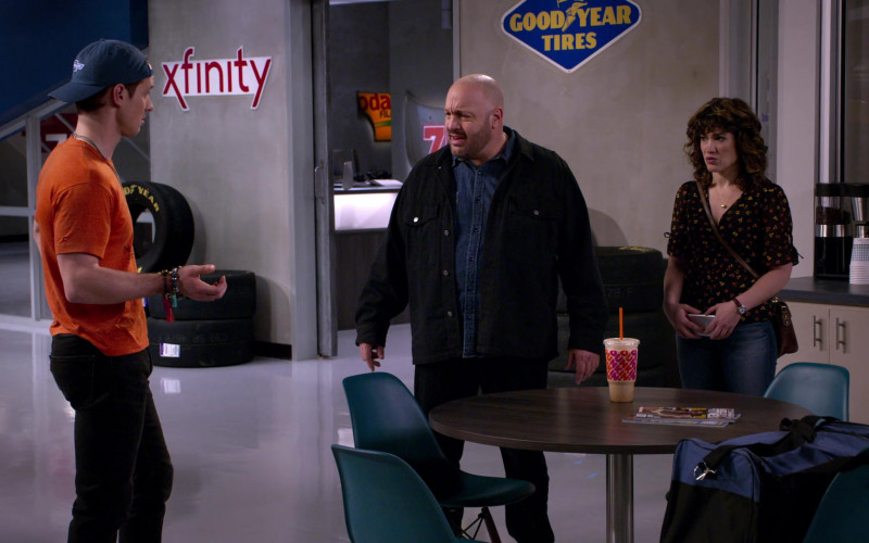 Xfinity and Goodyear Tires Signs and Dunkin' Coffee Drink in The Crew S01E01