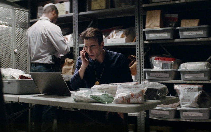 Dell Laptop of Nicholas Jarecki as Stanley Foster in Crisis (2021)