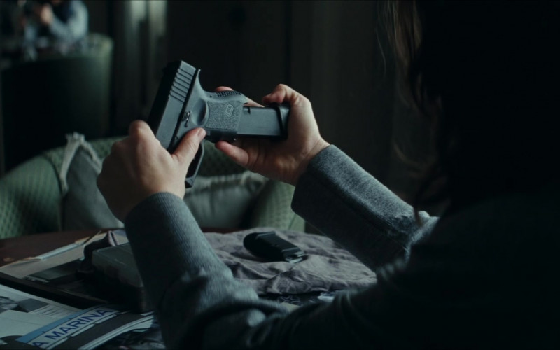 Glock Pistol of Evangeline Lilly as Claire Reimann in Crisis (2021)