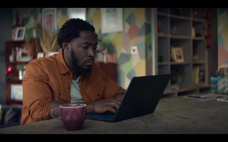 Microsoft Surface Laptop of Eric Kofi-Abrefa as Mark Bailey in The One S01E08 (2021)