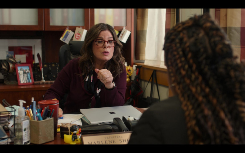 Microsoft Surface Laptop of Marcia Gay Harden as Principal Marlene Shelly in Moxie Movie by Netflix (1)