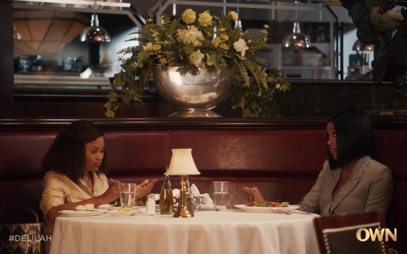 Taittinger Champagne Flower Vase in Delilah S01E01 Everything to Everybody (2021)