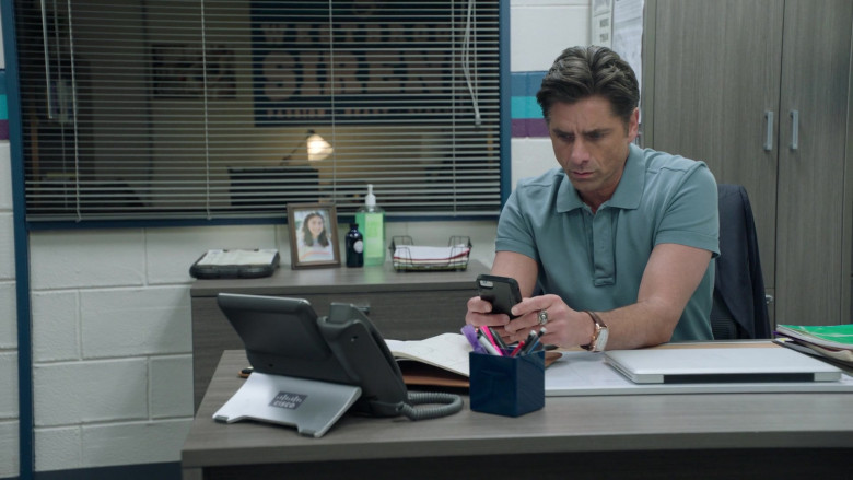 Cisco Phone of John Stamos as Marvyn Korn in Big Shot S01E03 TCKS (2021)