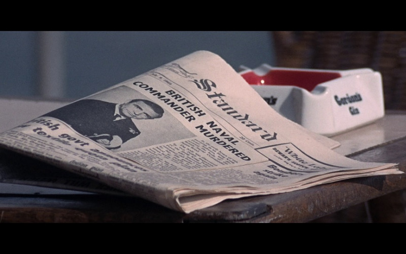 Hongkong Standard newspaper, Dewar's whisky white label ad & Gordon's Gin ashtray in You Only Live Tw