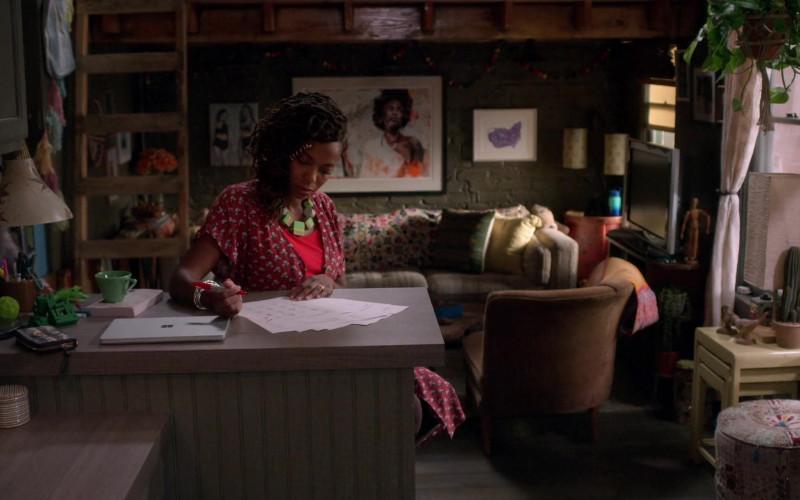 Microsoft Surface Laptop of Sasheer Zamata as Denise in Home Economics S01E01 Pilot (2021)