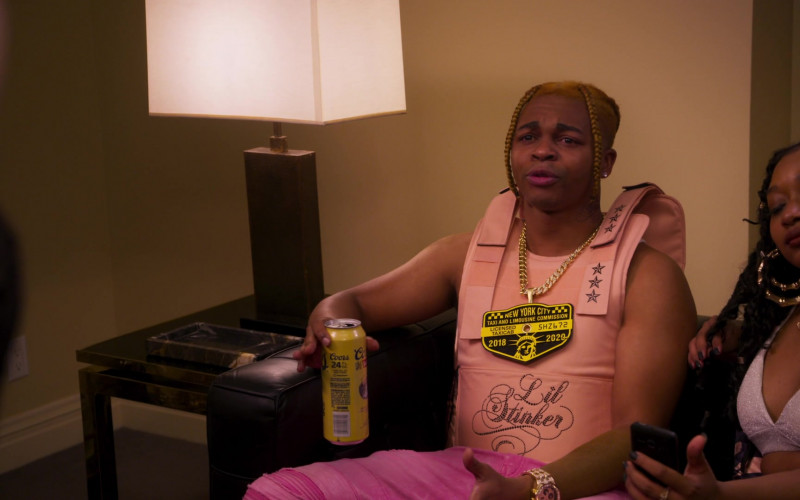 Coors Banquet Beer Enjoyed by Jeremiah Craft as Lil Stinker in Girls5eva S01E01 Pilot (2021)