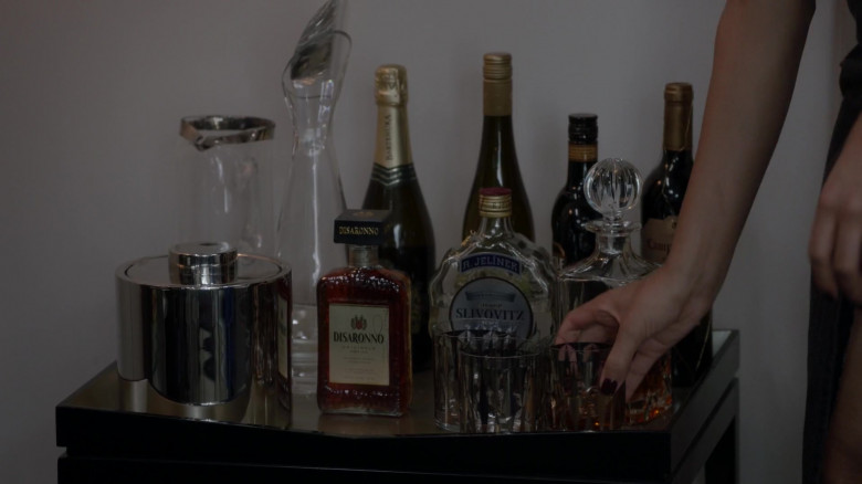 Disaronno Liqueur and R. Jelinek Slivovitz Bottle in Pose S03E01 On the Run (2021)