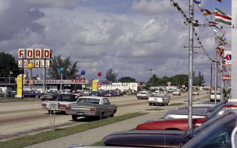 Ford dealership, Kitchenaid, Pepsi Billboard & Burger King in Goldfinger (1964)