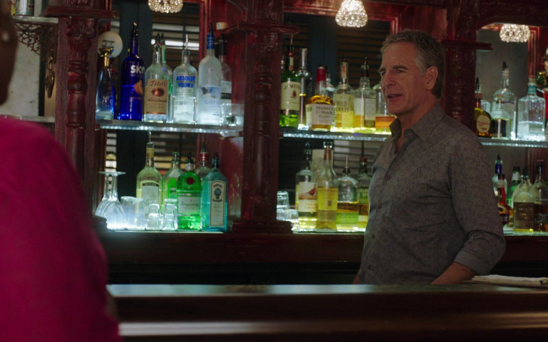 Skyy Vodka, Tito's, Absolut, Grey Goose, Jameson Whiskey, Maker's Mark, Wild Turkey 101 Bourbon, Bombay Sapphire Gin in NCIS New Orleans Illusions (2021)