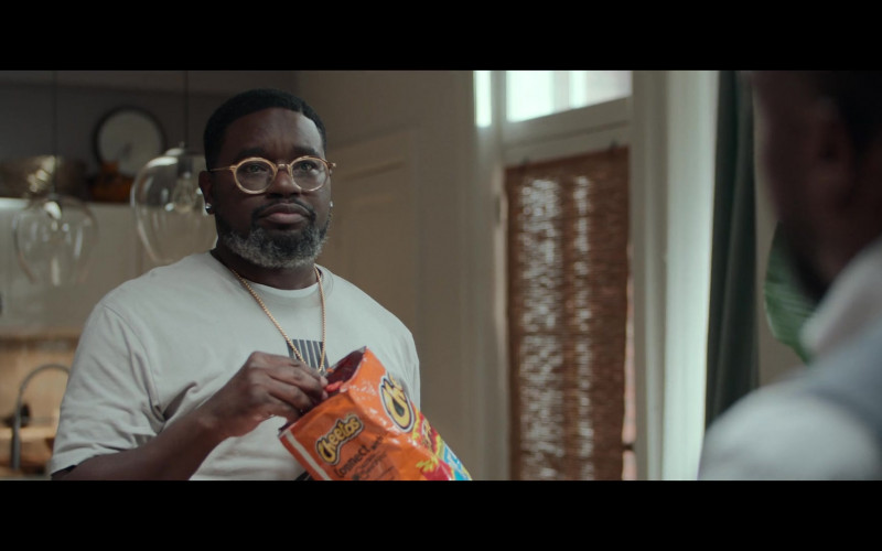 Cheetos cheese puff snack Enjoyed by Lil Rel Howery as Jordan in Fatherhood (2021)