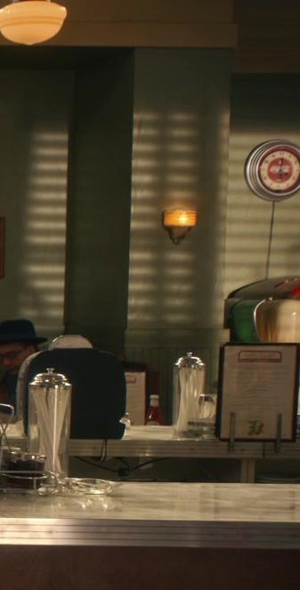 Coca-Cola Wall Round Clock in Why Women Kill S02E02 The Woman in the Window (2021)