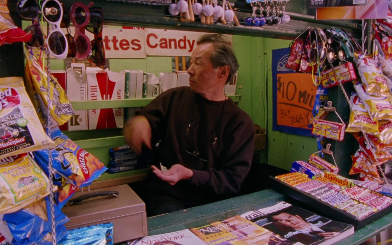 Lay's Chips, Crunch Chocolate Bars, Starburst, 3 Musketers, Snickers, Mars, Twix, Barnum's Animals, New York Magazine in Sex and the City S02E04