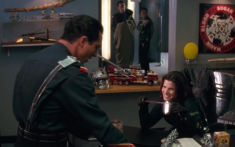Wilson Football of Sandra Bullock as Lieutenant Lenina Huxley in Demolition Man (1993)